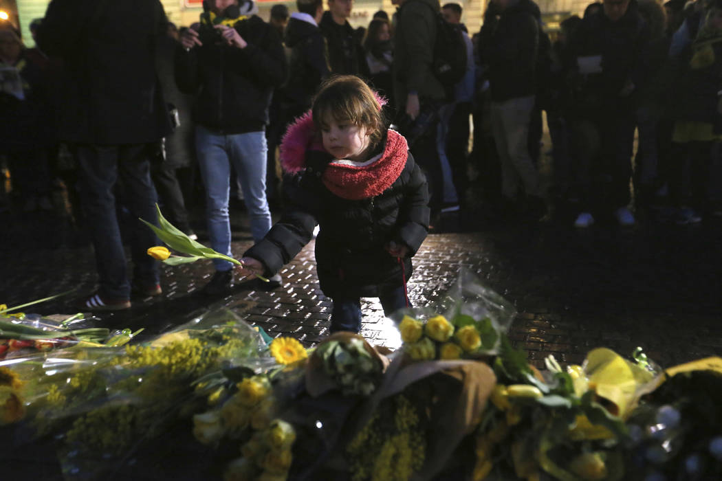 Residents of Nantes, western France, and FC Nantes soccer fans are gathered in the city center to pay tribute to FC Nantes soccer player Emiliano Sala of Argentina, Tuesday, Jan. 22, 2019. The Fre ...