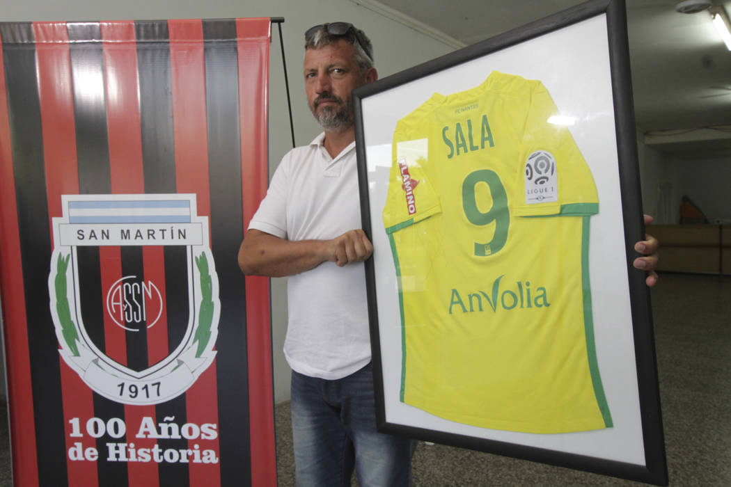 Club Atletico Social San Martin President Daniel Rivero holds a Nantes team jersey that was given to the club by Argentine soccer player Emiliano Sala, in Progreso, Santa Fe, Argentina Tuesday, Ja ...