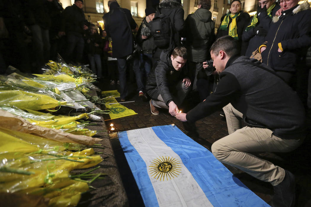 Supporters gather to pay tribute to Argentinian soccer player Emiliano Sala, in Nantes, western France, Tuesday, Jan. 22, 2018. The search for the missing plane taking Argentine soccer player Emil ...