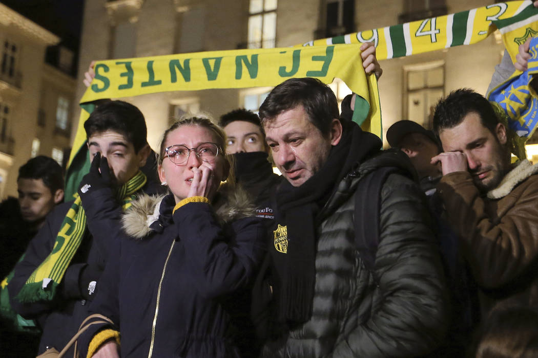 Supporters of FC Nantes gather to pay tribute to Argentinian soccer player Emiliano Sala, in Nantes, western France, Tuesday, Jan. 22, 2018. The search for the missing plane taking Argentine socce ...