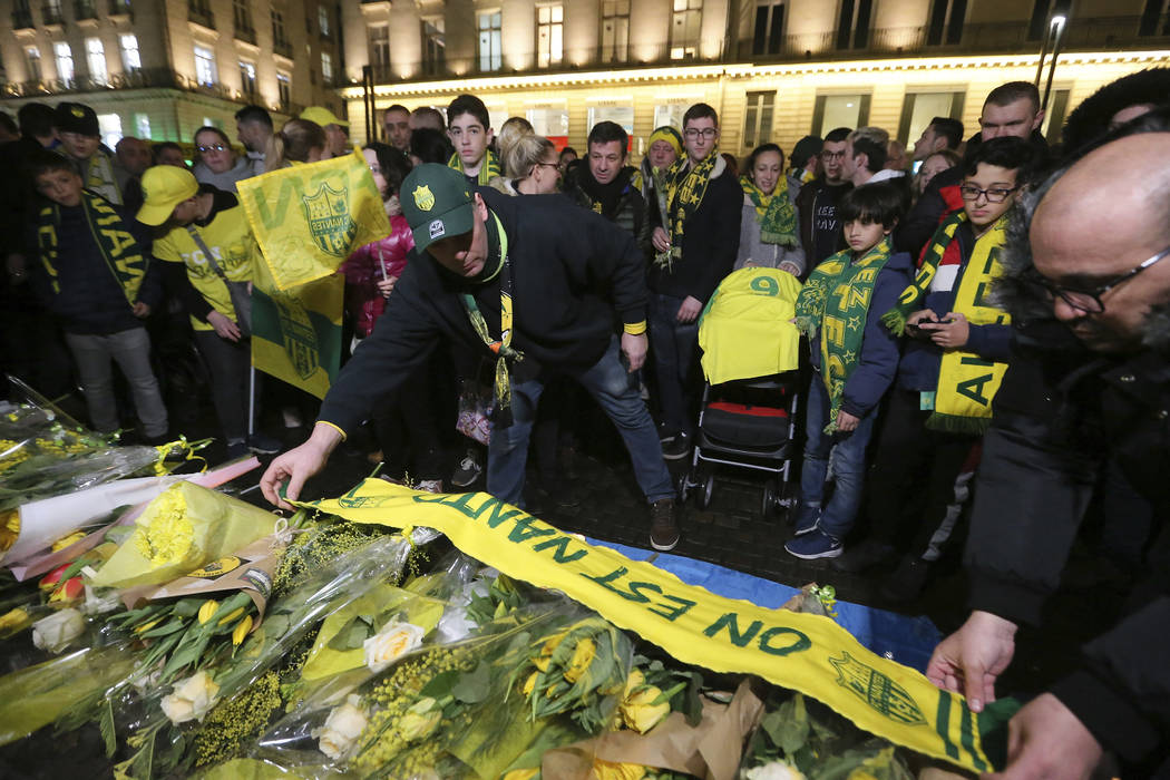 Supporters gather to pay tribute to Argentinian soccer player Emiliano Sala, in Nantes, western France, Tuesday, Jan. 22, 2019. The search for the missing plane taking Argentine soccer player Emil ...