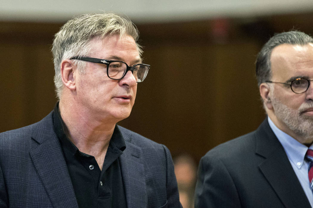 Actor Alec Baldwin, left, stands with his attorney during a hearing, Wednesday, Jan. 23, 2019, in New York on charges that he slugged a man during a dispute over a parking spot last fall. (Erik Th ...