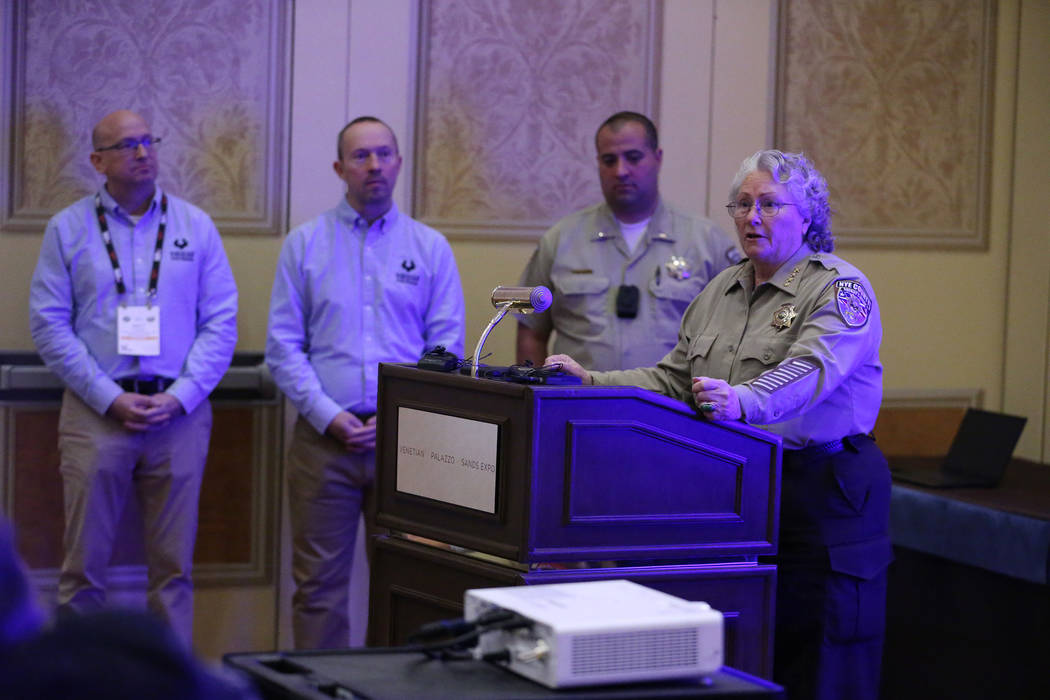 Nye County Sheriff Sharon Wehrly speaks on her department using Viridian Weapon Technologies weapon mounted camera during the SHOT Show at the Sands Expo Convention Center in Las Vegas, Wednesday, ...