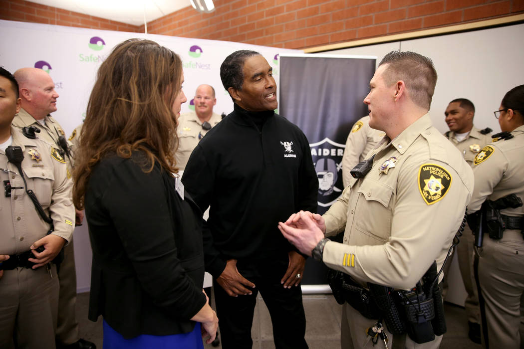 SafeNest CEO Liz Ortenburger visits with Las Vegas police Lt. Timothy Hatchett and Raiders alumnus Leo Gray at SafeNest headquarters in Las Vegas on Thursday, Jan. 24, 2019. Hatchett initiated Pro ...