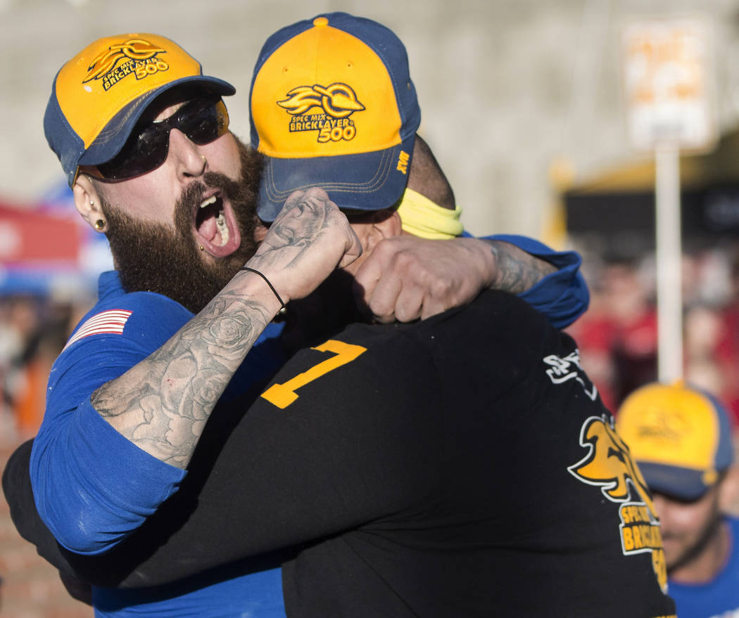 Mario Alves, left, from Hamilton, Ontario celebrates with teammate and brother Michael Alves after winning the Spec Mix Bricklayer 500 during day two of the World of Concrete trade show on Wednesd ...