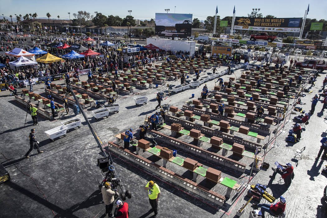 Teams race to build their walls during the Spec Mix Bricklayer 500 during day two of the World of Concrete trade show on Wednesday, Jan. 23, 2019, at the Las Vegas Convention Center, in Las Vegas. ...