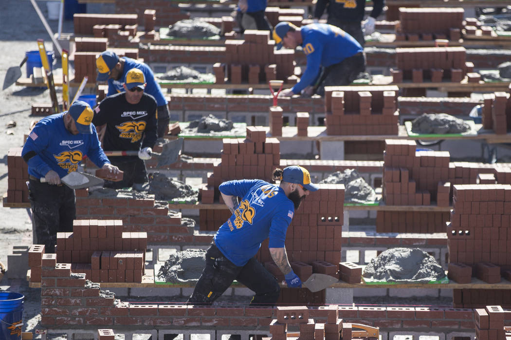 Mario Alves, middle, from Hamilton, Ontario competes in the Spec Mix Bricklayer 500 during day two of the World of Concrete trade show on Wednesday, Jan. 23, 2019, at the Las Vegas Convention Cent ...