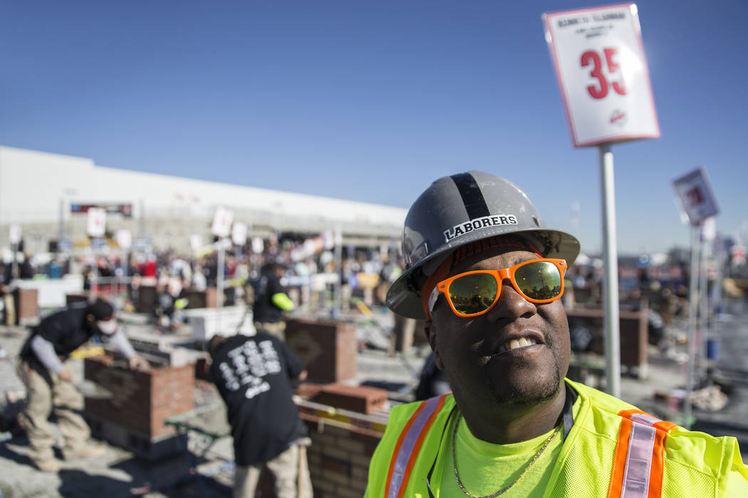 Kenneth McLin, right, with Liuna, takes a break during a masonry competition during day two of the World of Concrete trade show on Wednesday, Jan. 23, 2019, at the Las Vegas Convention Center, in ...
