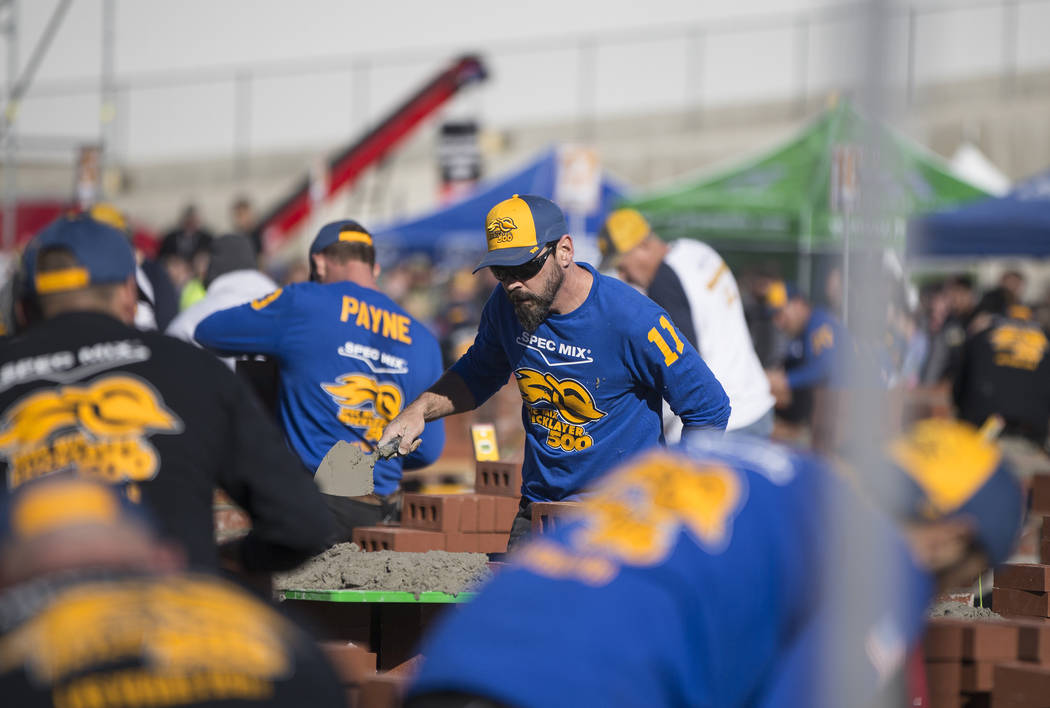 David Wernette, middle, from Marysville, Wash., competes in the Spec Mix Bricklayer 500 during day two of the World of Concrete trade show on Wednesday, Jan. 23, 2019, at the Las Vegas Convention ...