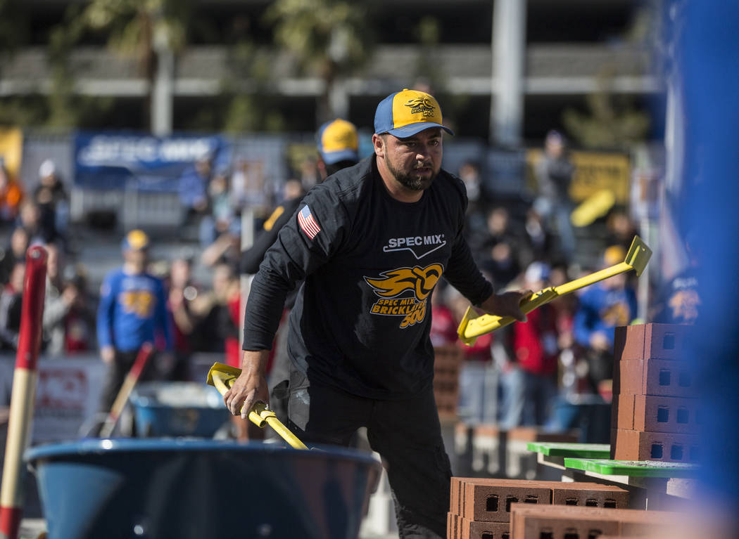 Matt Jones, from Phoenix, builds a wall during a masonry competition during day two of the World of Concrete trade show on Wednesday, Jan. 23, 2019, at the Las Vegas Convention Center, in Las Vega ...