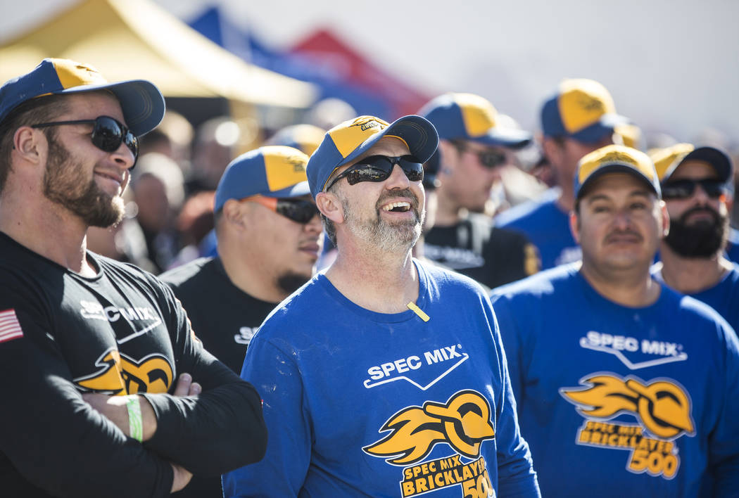 Dave Sontag, middle, from Calgary, Alberta shares a laugh with teammates before the start of the Spec Mix Bricklayer 500 during day two of the World of Concrete trade show on Wednesday, Jan. 23, 2 ...