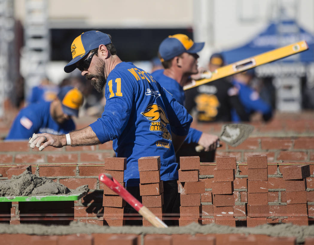 David Wernette, left, from Marysville, Wash., competes in the Spec Mix Bricklayer 500 during day two of the World of Concrete trade show on Wednesday, Jan. 23, 2019, at the Las Vegas Convention Ce ...