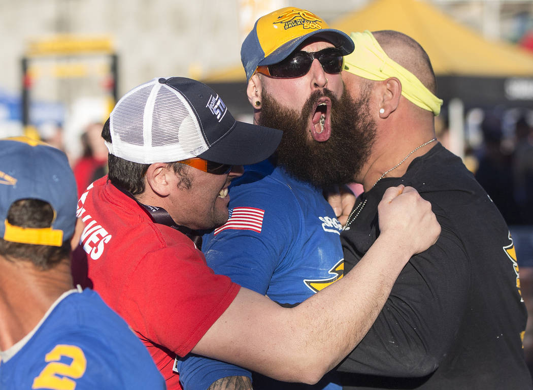 Mario Alves, middle, from Hamilton, Ontario celebrates with his team after winning the Spec Mix Bricklayer 500 during day two of the World of Concrete trade show on Wednesday, Jan. 23, 2019, at th ...