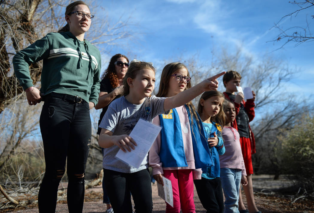 Rae Puckett, 8, points out at something as the group of children gathered for the Young Explorers event look on at the Las Vegas Wetlands Park in Las Vegas, Sunday, Jan. 27, 2019. Caroline Brehman ...