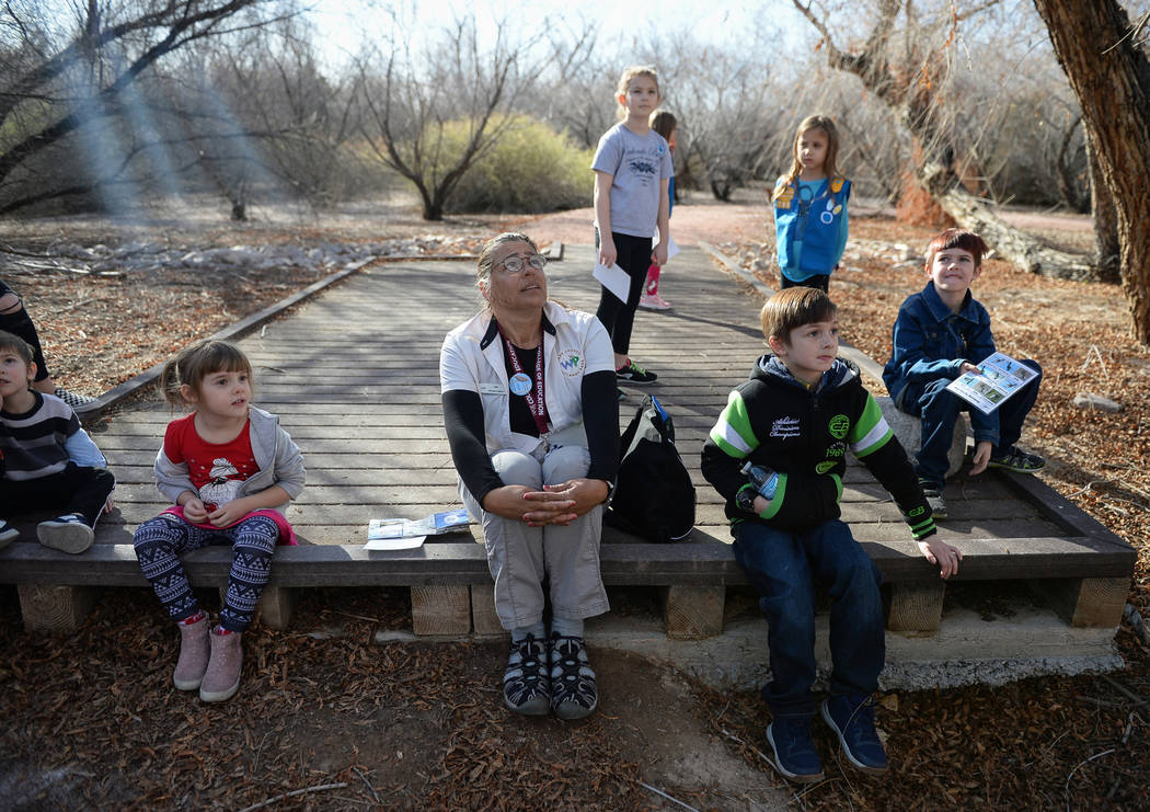 A group of children gathered for the Young Explorers event lead by Recreation Assistant Kate Bloomfield sit and listen for animal noises at the Las Vegas Wetlands Park in Las Vegas, Sunday, Jan. 2 ...