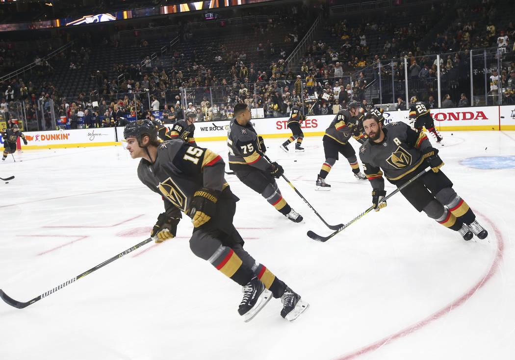 Golden Knights defensemen Jon Merrill (15) and Deryk Engelland (5) warm up before taking on the Nashville Predators in an NHL hockey game at T-Mobile Arena in Las Vegas on Wednesday, Jan. 23, 2019 ...