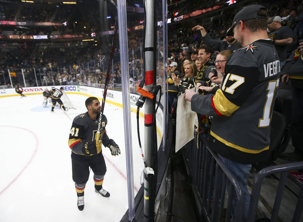 Golden Knights center Pierre-Edouard Bellemare (41) sends a puck over to a group of fans while warming up before taking on the Nashville Predators in an NHL hockey game at T-Mobile Arena in Las Ve ...