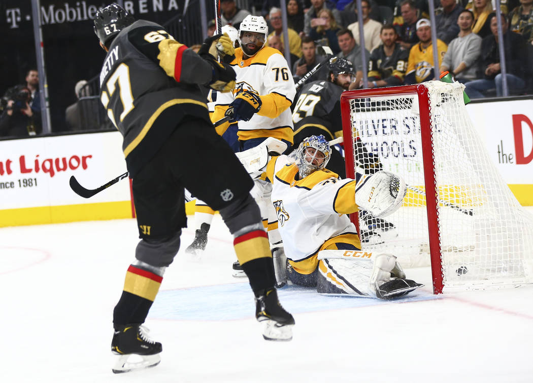 Golden Knights left wing Max Pacioretty (67) scores a goal past Nashville Predators goaltender Juuse Saros (74) during the first period of an NHL hockey game at T-Mobile Arena in Las Vegas on Wedn ...