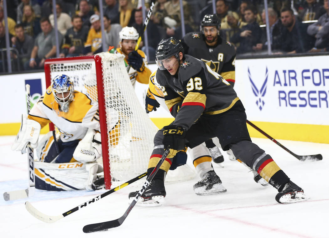 Golden Knights left wing Tomas Nosek (92) moves the puck around before attempting a shot against the Nashville Predators during the first period of an NHL hockey game at T-Mobile Arena in Las Vega ...