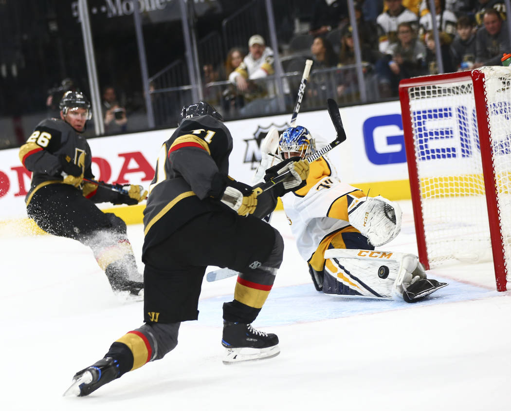 Nashville Predators goaltender Juuse Saros (74) blocks a shot from Golden Knights center William Karlsson (71) during the second period of an NHL hockey game at T-Mobile Arena in Las Vegas on Wedn ...