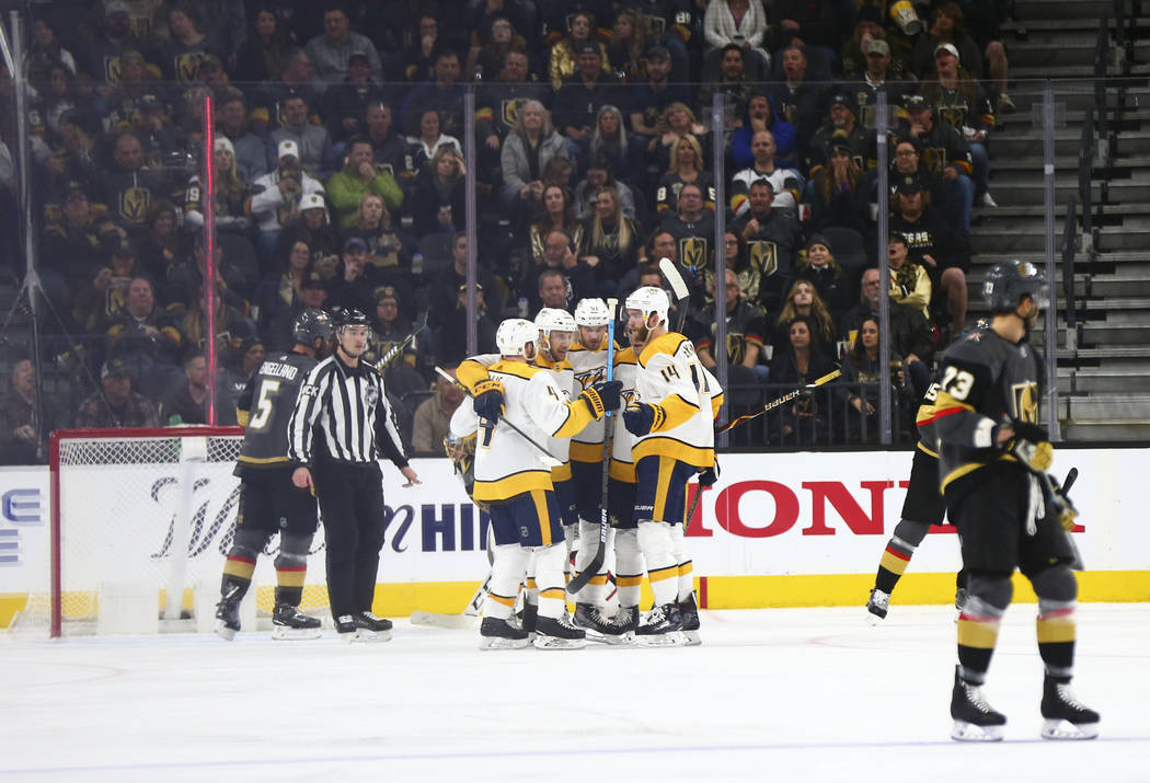 Nashville Predators players celebrate their first goal against the Golden Knights during the second period of an NHL hockey game at T-Mobile Arena in Las Vegas on Wednesday, Jan. 23, 2019. (Chase ...