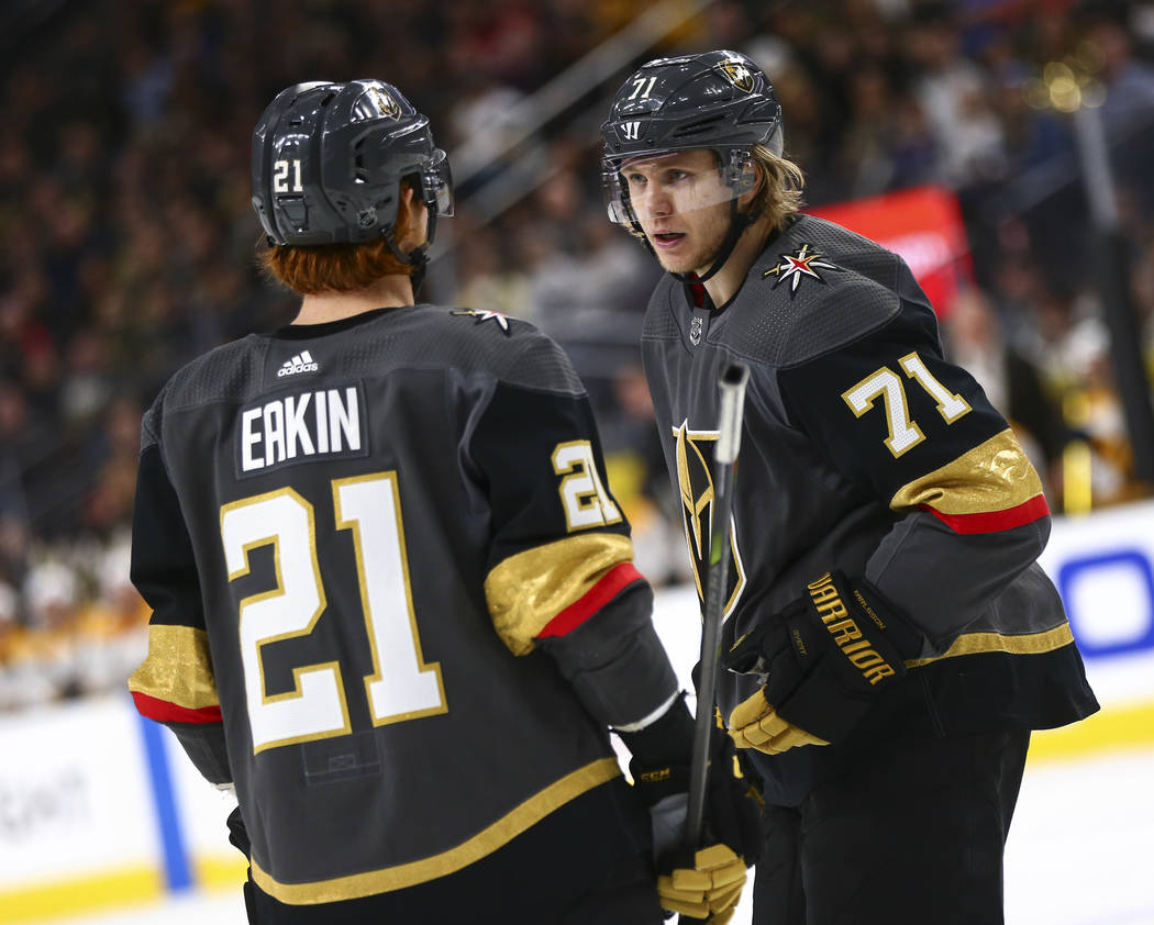 Golden Knights center William Karlsson (71) talks with Golden Knights center Cody Eakin (21) during the second period of an NHL hockey game against the Nashville Predators at T-Mobile Arena in Las ...
