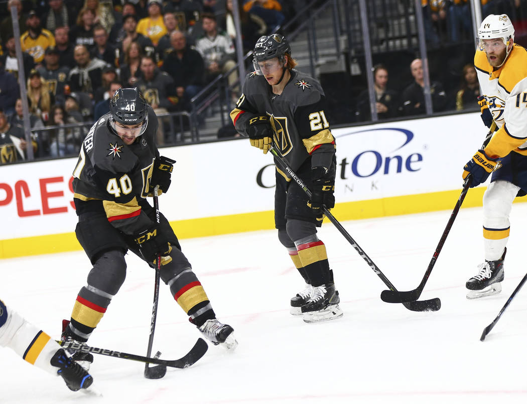 Golden Knights center Ryan Carpenter (40) looks to shoot the puck against the Nashville Predators as Cody Eakin (21) looks on during the second period of an NHL hockey game at T-Mobile Arena in La ...