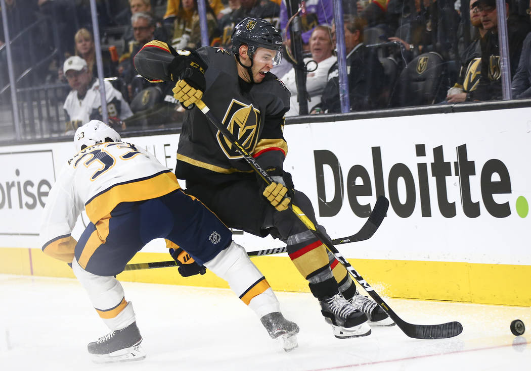 Golden Knights defenseman Brayden McNabb (3) moves the puck past Nashville Predators right wing Viktor Arvidsson (33) during the third period of an NHL hockey game at T-Mobile Arena in Las Vegas o ...