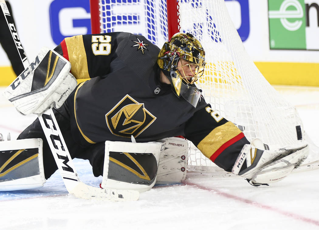 Golden Knights goaltender Marc-Andre Fleury (29) blocks a shot from the Nashville Predators during the third period of an NHL hockey game at T-Mobile Arena in Las Vegas on Wednesday, Jan. 23, 2019 ...