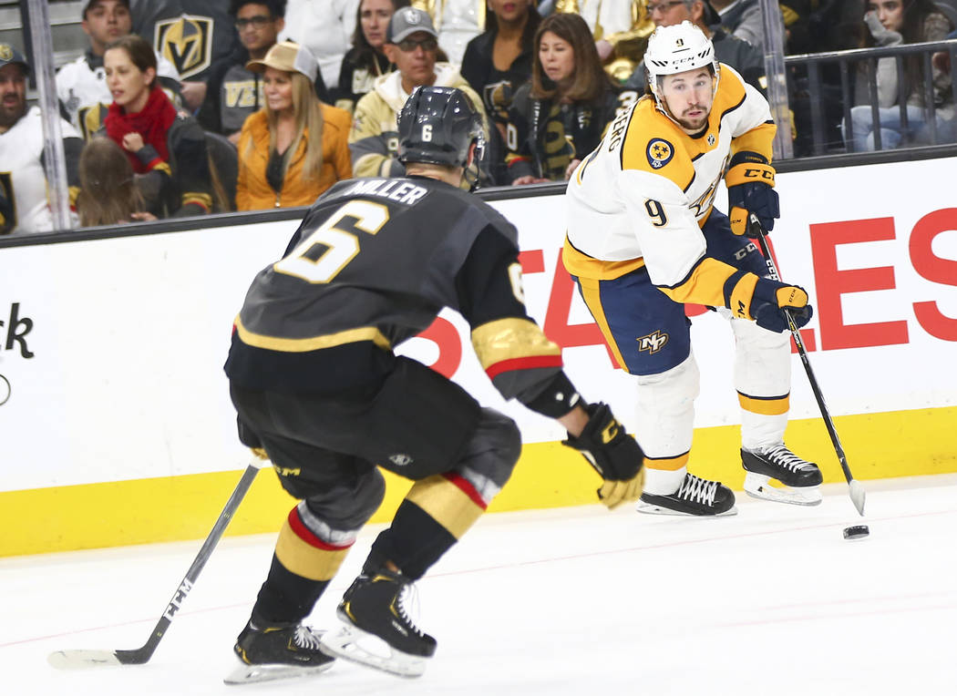 Nashville Predators left wing Filip Forsberg (9) moves the puck against Golden Knights defenseman Colin Miller (6) during the third period of an NHL hockey game at T-Mobile Arena in Las Vegas on W ...