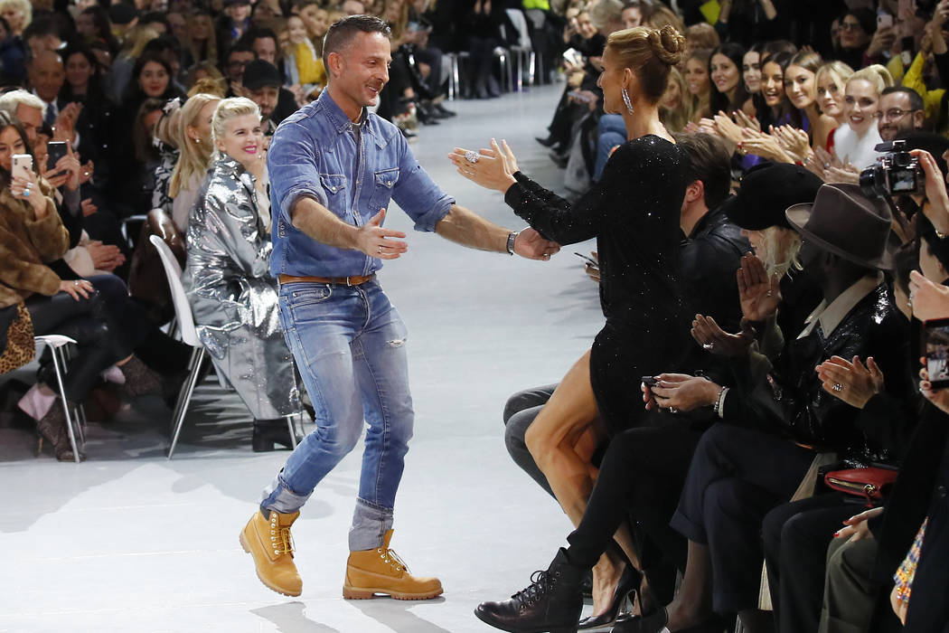 Singer Celine Dion, right, congratulates designer Alexandre Vauthier after his Spring/Summer 2019 Haute Couture fashion collection presented in Paris, Tuesday Jan. 22, 2019. (AP Photo/Francois Mori)