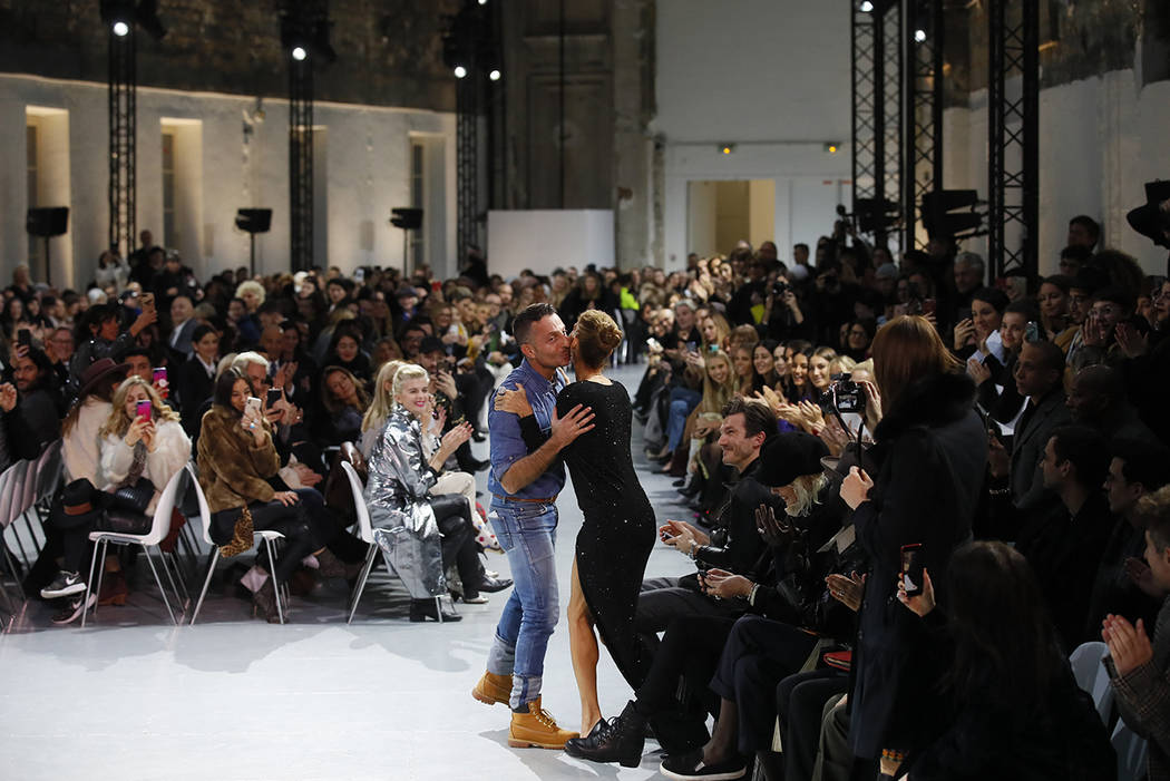 Singer Celine Dion, centre right, kisses designer Alexandre Vauthier after his Spring/Summer 2019 Haute Couture fashion collection presented in Paris, Tuesday Jan. 22, 2019. (AP Photo/Francois Mori)