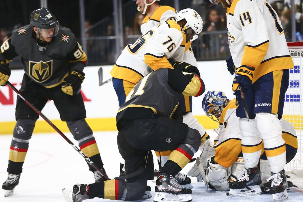 Nashville Predators defenseman P.K. Subban (76) holds down Golden Knights center Pierre-Edouard Bellemare (41) during the second period of an NHL hockey game at T-Mobile Arena in Las Vegas on Wedn ...