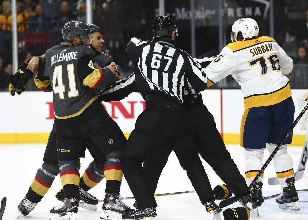 Nashville Predators defenseman P.K. Subban (76) tries to fight Golden Knights' Pierre-Edouard Bellemare (41) Ryan Reaves (75) during the second period of an NHL hockey game at T-Mobile Arena in La ...