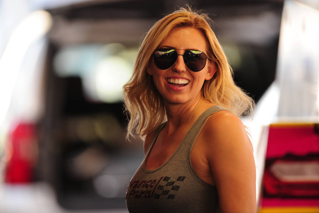 NHRA Funny Car driver Courtney Force signs autographs in a hospitality tent during day one of qualifying for the Mello Yello NHRA Toyota Nationals at The Strip at Las Vegas Motor Speedway Friday O ...