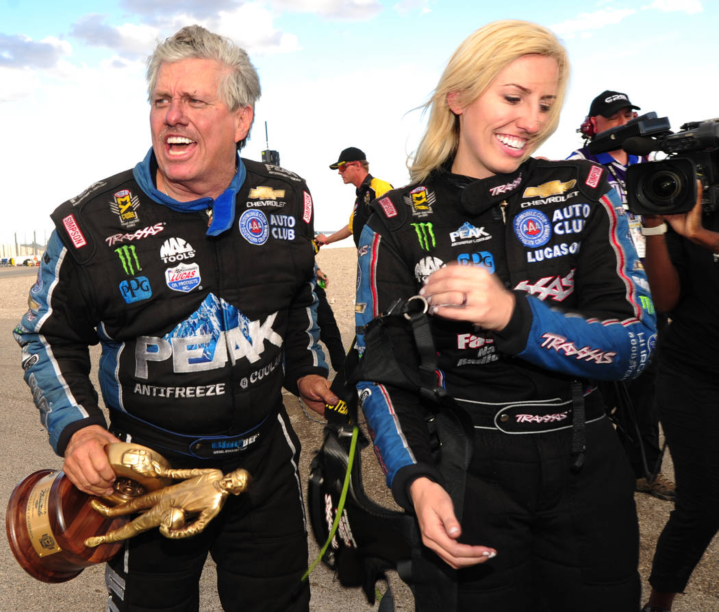 Funny Car John Force, left, and daughter and fellow Funny Car driver Courtney Force are seen after John defeated her in the final round of Funny Car during the NHRA Mello Yello Series Toyota Natio ...