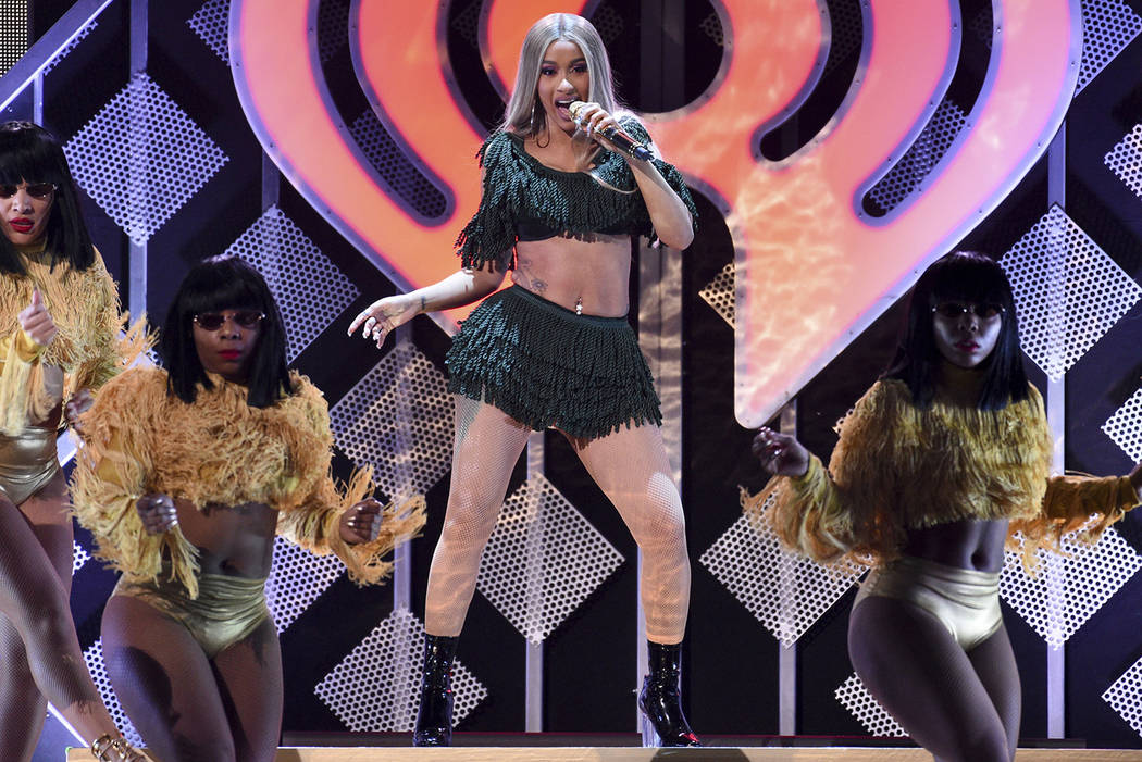 In this Dec. 7, 2018 file photo, hip-hop recording artist Cardi B performs at Z100's iHeartRadio Jingle Ball in New York. (Photo by Evan Agostini/Invision/AP, File)