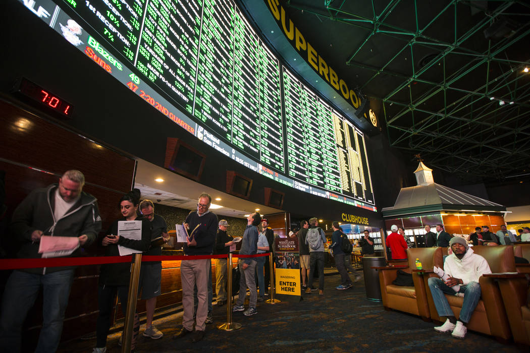 Bettors line up to place prop bets for the Super Bowl at the Westgate Superbook in Las Vegas on Thursday, Jan. 24, 2019. The sportsbook posted 442 two-way props and more than 1,000 betting options ...