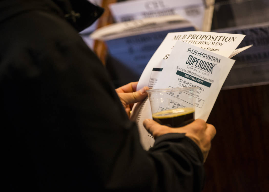 Bettors look through prop bets for the Super Bowl at the Westgate Superbook in Las Vegas on Thursday, Jan. 24, 2019. The sportsbook posted 442 two-way props and more than 1,000 betting options. (C ...