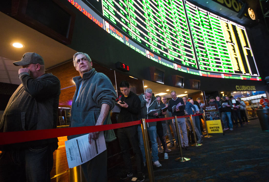 Bettors, including a Milwaukee man who gave his name as Johnny Rocco, left, line up to place prop bets for the Super Bowl at the Westgate Superbook in Las Vegas on Thursday, Jan. 24, 2019. The spo ...