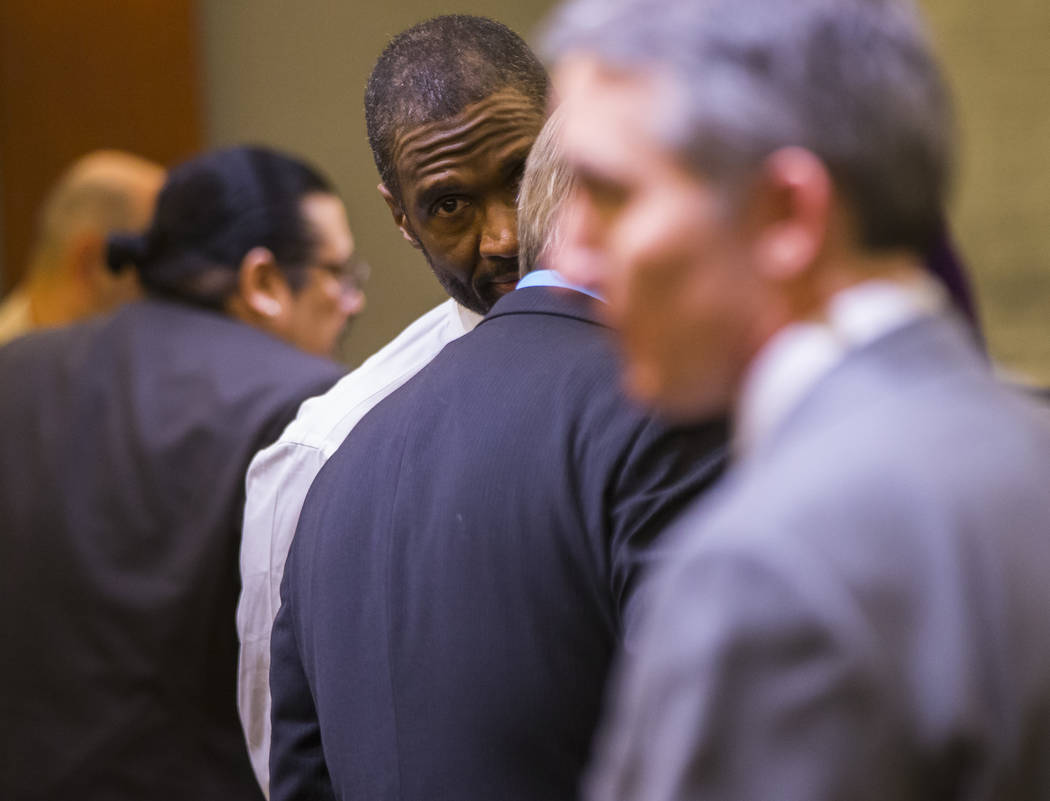 Emilio Arenas talks with his defense attorney after being found guilty on multiple counts, including first degree murder, at Regional Justice Center in Las Vegas on Friday, Jan. 25, 2019. Arenas w ...