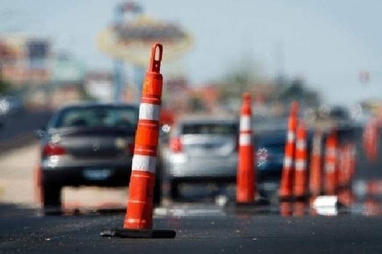 Motorists maneuver through traffic cones in a construction zone. (John Locher/Review-Journal File)