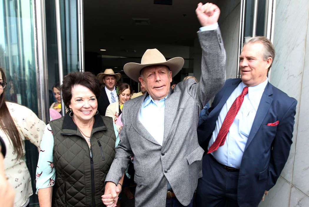 Cliven Bundy walks out of Lloyd George U.S. Courthouse in Las Vegas a free man with his wife Carol Monday, Jan. 8, 2018, after a federal judge dismissed the case with prejudice against him, two of ...