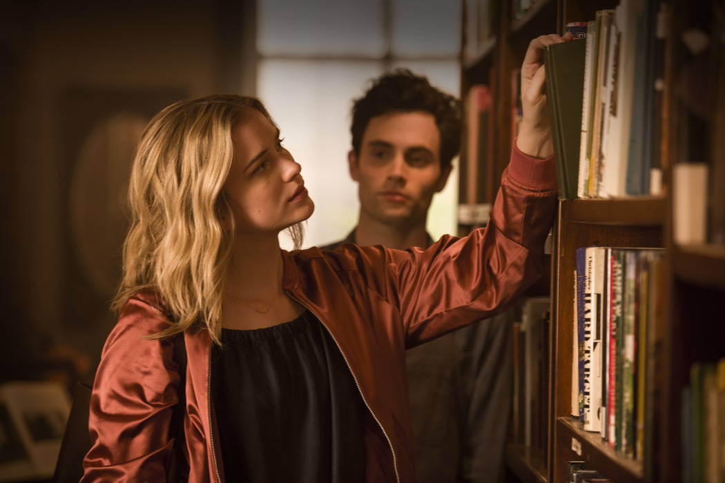 "Elizabeth Lail and Penn Badgley in ""You"" (Netflix)"