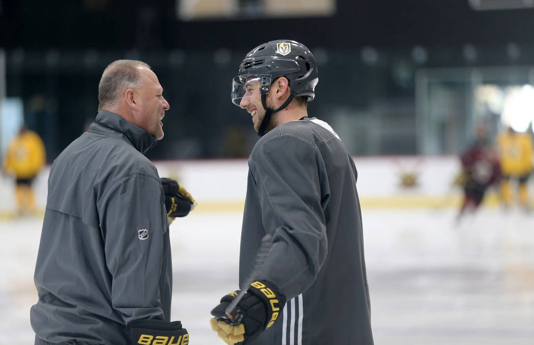 Vegas Golden Knights defenseman Shea Theodore with coach Gerard Gallant during practice at City National Arena in Las Vegas Thursday, Sept. 27, 2018. It was his first practice after signing a ...