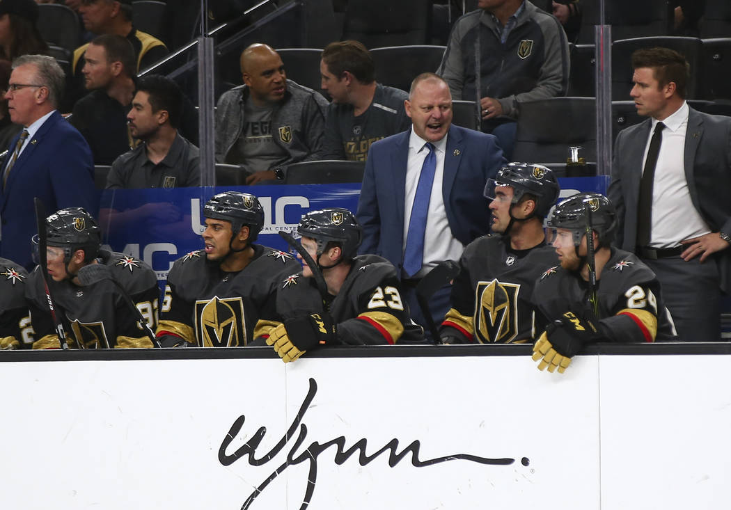 Golden Knights head coach Gerard Gallant, center right, talks to his team during the second period of an NHL hockey game against the Washington Capitals at T-Mobile Arena in Las Vegas on Tuesday, ...