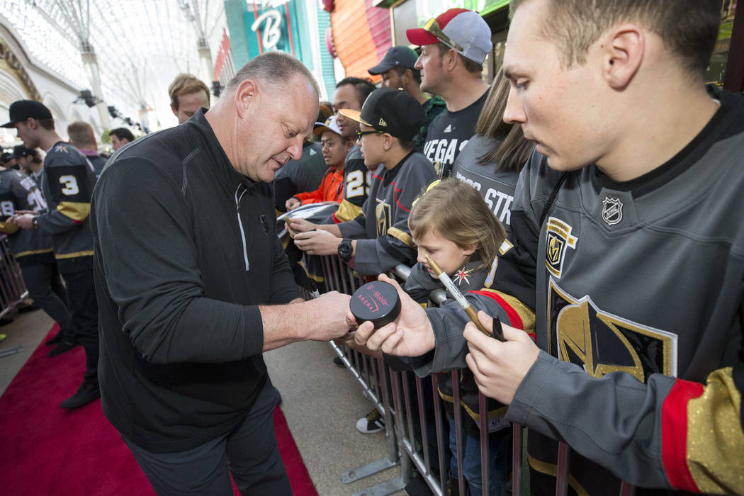 Vegas Golden Knights head coach Gerard Gallant signs autographs during the team's first fan fest at the Fremont Street Experience in downtown Las Vegas on Sunday, Jan. 14, 2018. Richard Brian Las ...