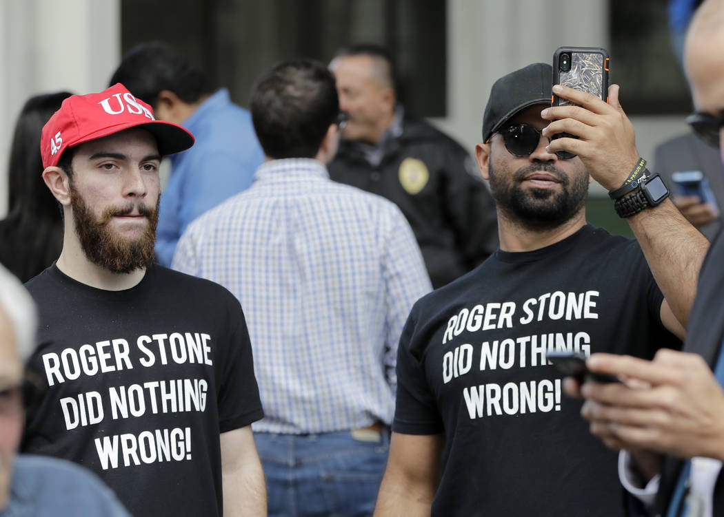 Supporters of Roger Stone, a confidant of President Donald Trump, stand outside of the federal courthouse during a hearing, Friday, Jan. 25, 2019, in Fort Lauderdale, Fla. Stone was arrested Frida ...