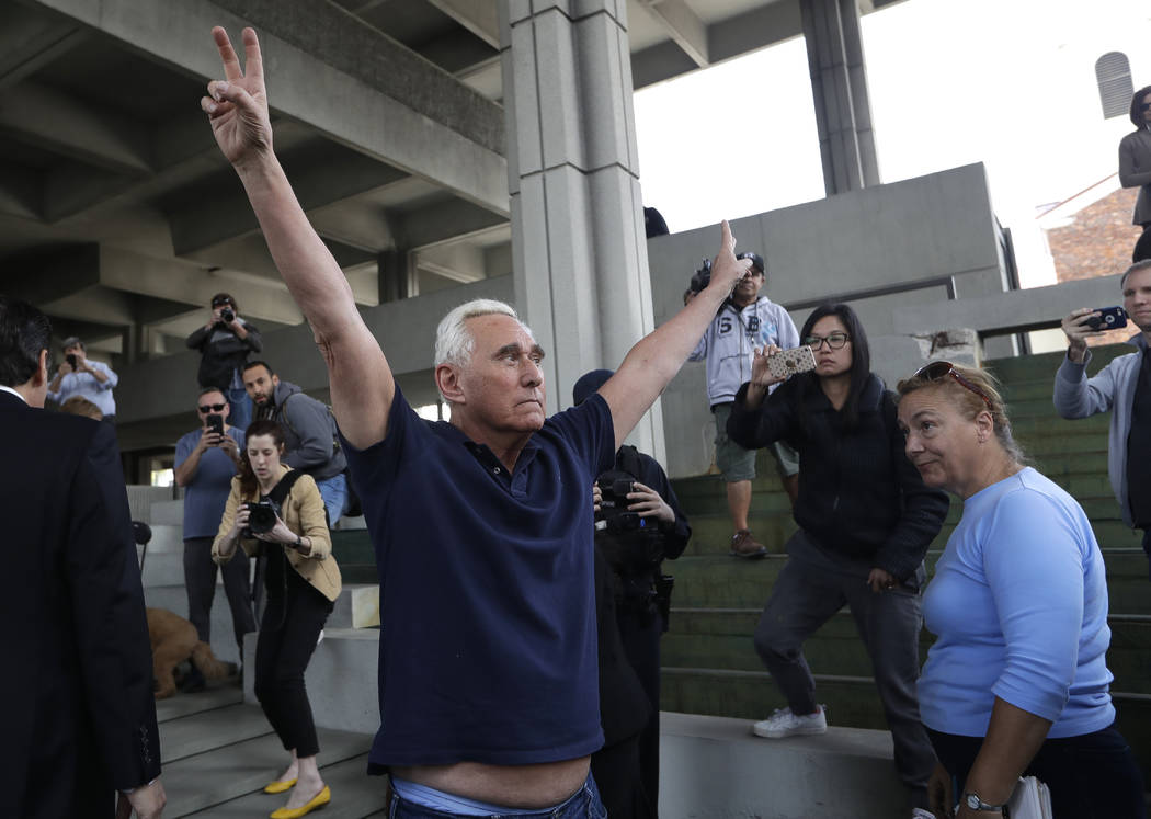 Roger Stone, a confidant of President Donald Trump, raises his arms as he leaves the federal courthouse following a hearing, Friday, Jan. 25, 2019, in Fort Lauderdale, Fla. Stone was arrested Frid ...