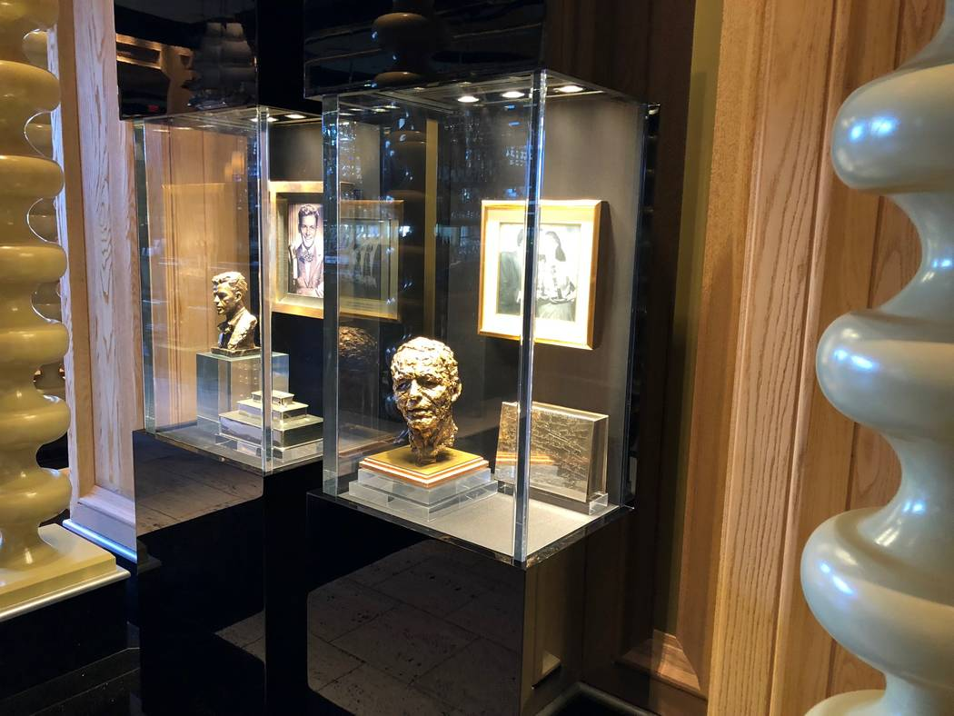 A glass showcase at Encore includes miniature busts of Frank Sinatra. (Norm Clarke)